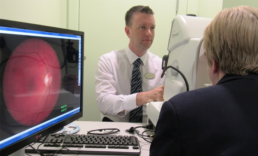 Specsavers optometrist carries out a glaucoma assessment - IGA partnership