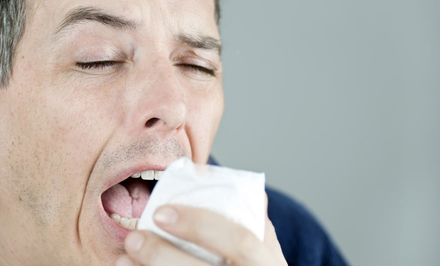 Man-sneezing-into-tissue-Infection-control