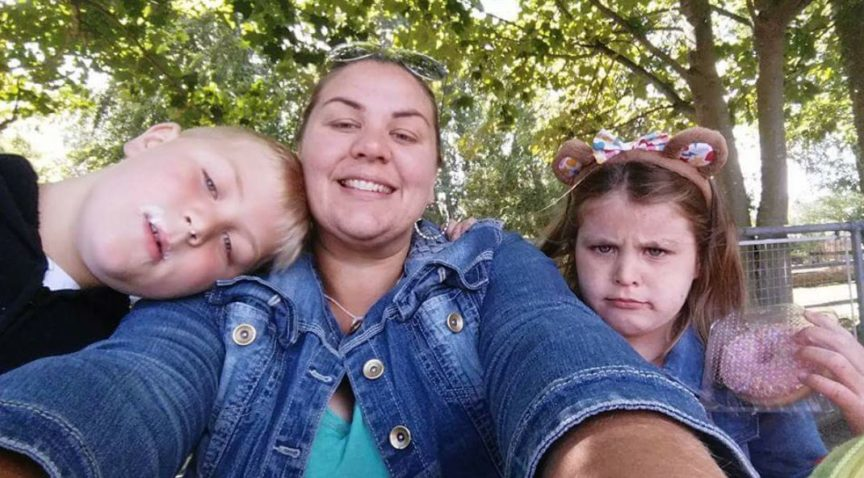 Stacey Hughes who suffered a detached retina pictured with her two children