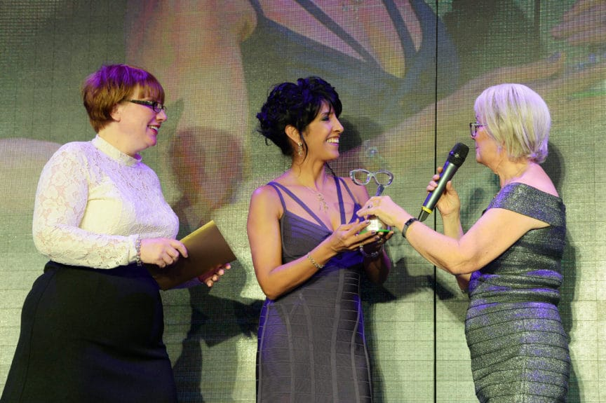 Specsavers customer Michelle Crawford (left) and optometric director of Specsavers Lanark Rubena Kerr receiving the Dame Mary Award for Professionalism and Expertise