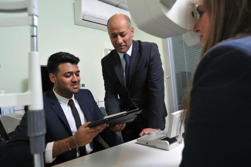 Specsavers Wembley ophthalmic director Rakesh Kapoor with University of Hertfordshire Master of optometry pre-reg student Jayant Hirani
