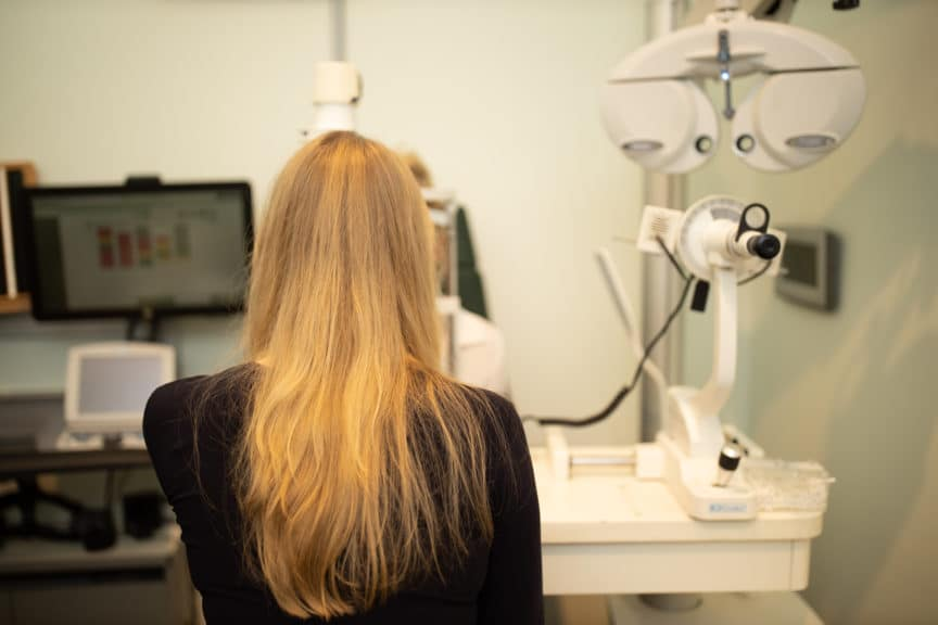 girl with long blonde hair in Specsavers test room