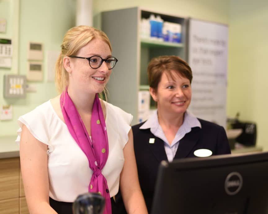 Specsavers female staff smiling