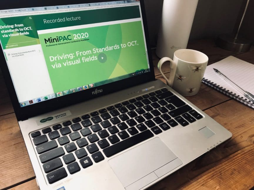 Specsavers online learning on laptop at desk