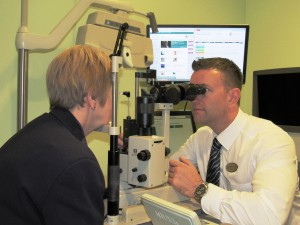 Craig-MacKenzie-ophthalmic-optician-performing-a-glaucoma-assessment-at-the-Specsavers-eye-care-centre-in-gwent
