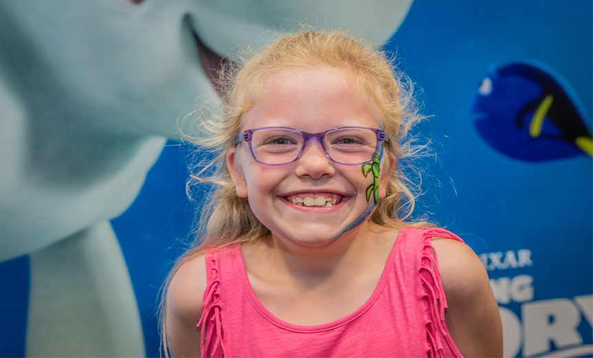 girl wearing Finding Dory glasses